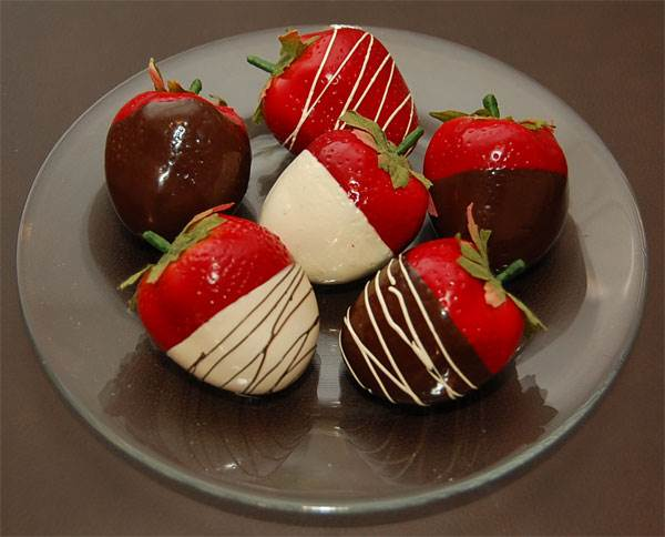 Assorted Dipped Strawberries On Plate